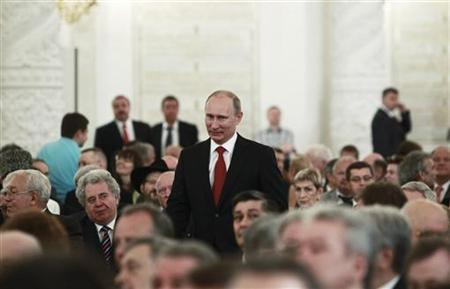 Russia's Prime Minister Vladimir Putin (C) attends an award ceremony to mark the Day of Russia in Moscow's Kremlin June 12, 2011. REUTERS/Sergei Karpukhin