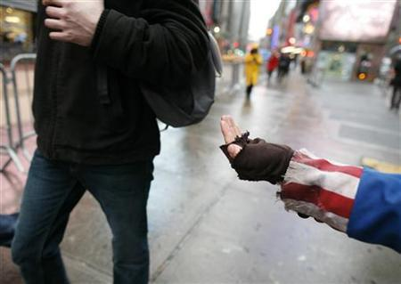 A protester dressed as a panhandling Uncle Sam stands in New York's Time Square October 28, 2009. REUTERS/Brendan McDermid