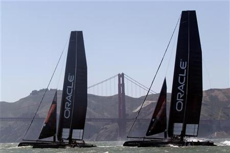 With the Golden Gate Bridge in the background, two Oracle Racing AC45 boats sail in an exhibition race to promote the 34th Annual America's Cup, in San Francisco Bay June 13, 2011. REUTERS/Beck Diefenbach
