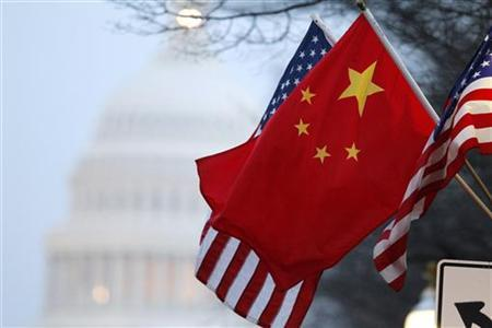The People's Republic of China flag and the U.S. Stars and Stripes fly along Pennsylvania Avenue near the U.S. Capitol in Washington during Chinese President Hu Jintao's state visit, January 18, 2011. REUTERS/Hyungwon Kang