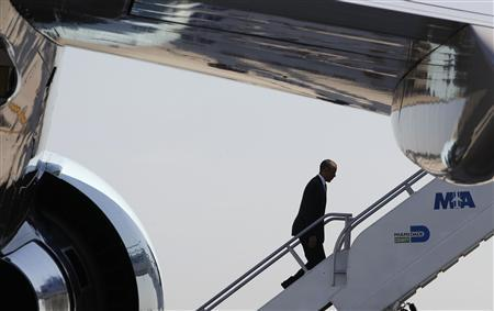 President Obama departs aboard Air Force One at the Miami International Airport in Florida for Puerto Rico, June 14, 2011. REUTERS/Larry Downing