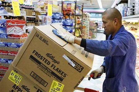 A store employee moves boxes full of of Kellogg's cereal in a supermarket in New York April 29, 2008. REUTERS/Lucas Jackson