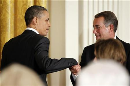 President Barack Obama greets House Speaker John Boehner (R-OH) before delivering remarks at a dinner of bipartisan committee chairmen and ranking members and their spouses in the East Room of the White House in Washington May 2, 2011. REUTERS/Jason Reed