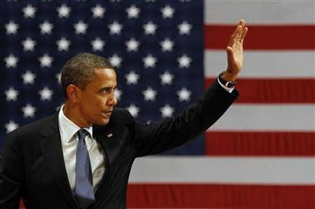 U.S. President Barack Obama waves after he speaks at the Adrienne Arsht Center for the Performing Arts in Miami, Florida, June 13, 2011. REUTERS/Larry Downing