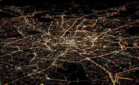 A general view of night Moscow is seen from the window of a passenger jet, October 8, 2010. REUTERS/Alexander Demianchuk