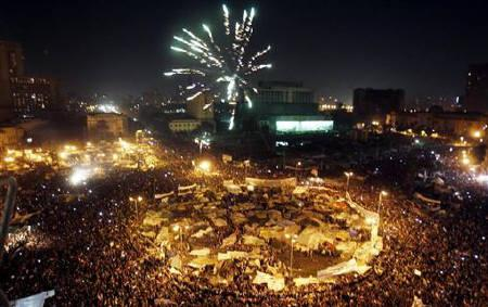 Thousands of Egyptian anti-government protesters celebrate inside Tahrir Square after the announcement of Egyptian President Hosni Mubarak's resignation in Cairo February 11, 2011. REUTERS/Amr Abdallah Dalsh/Files