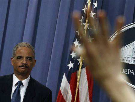 U.S. Attorney General Eric Holder listen to a question at a news conference in Washington, February 17, 2011. Holder defended the Obama administration's use of criminal courts to try terrorism suspects after a renewed call to send them to military trials at the naval base in Cuba. REUTERS/Jim Young/Files