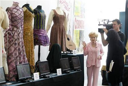 Actress Debbie Reynolds is interviewed at a preview of her vast Hollywood costume and prop collection in Beverly Hills June 6, 2011. REUTERS/Fred Prouser