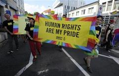 <p>Participants walk during the Rainbow Pride Parade in Bratislava June 4, 2011. REUTERS/Radovan Stoklasa</p>