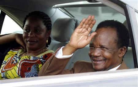 Former Zambian president Frederick Chiluba waves as he sits next to his wife Regina, as they visit the scene of a blast at BGRIMM Explosives Plant on the premises of the Chambishi copper mine, 400 km (250 miles) north of Zambia's capital Lusaka, in this file picture taken April 24, 2005. REUTERS/Salim Henry/Files