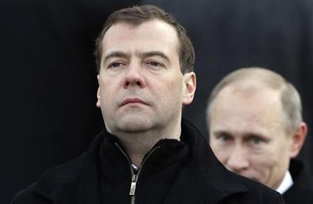 Russia's President Dmitry Medvedev (L) and Prime Minister Vladimir Putin are pictured outside Moscow's Kremlin in this February 23, 2011 file photo. REUTERS/Ivan Sekretarev/Pool