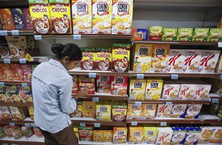 An employee arranges breakfast cereals on the shelves of a supermarket in Mumbai May 30, 2011. REUTERS/Vivek Prakash