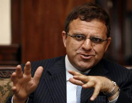 Afghan finance minister Hazrat Omar Zakhilwal speaks during an interview with Reuters in Kabul May 18, 2009. REUTERS/Omar Sobhani/Files