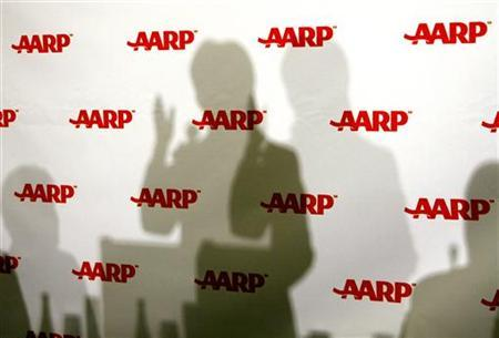 The shadows of U.S. Senator Hillary Clinton (D-NY) are seen as she speaks at the annual public policy meeting of the American Association of Retired Persons (AARP) in Washington February 13, 2007. REUTERS/Kevin Lamarque