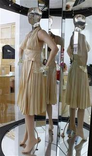 The ivory-pleated 'Subway' dress worn by actress Marilyn Monroe from the 1955 film ''The Seven Year Itch'' is shown June 6, 2011 at a preview of actress Debbie Reynold's vast Hollywood costume and prop collection. The collection was acquired over 50 years and is up for auction by Profiles in History in Beverly Hills on June 18. REUTERS/Fred Prouser