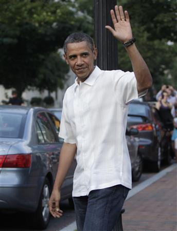 President Barack Obama waves as he walks out from Thomas Sweet ice cream in Washington June 19, 2011. REUTERS/Yuri Gripas