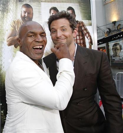 Mike Tyson (L) jokes with cast member Bradley Cooper at the premiere of ''The Hangover Part II'' at Grauman's Chinese theatre in Hollywood, California May 19, 2011. The movie opens in the U.S. on May 26. REUTERS/Mario Anzuoni