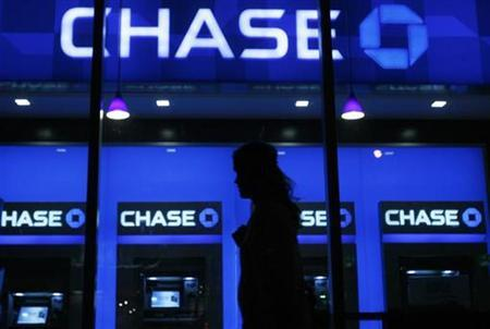 A woman walks past a JP Morgan Chase bank branch in New York, October 15, 2008. REUTERS/Lucas Jackson