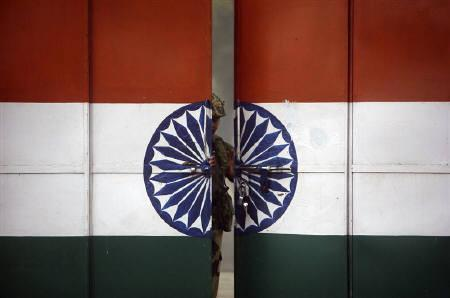 An Indian Border Security Force (BSF) soldier opens a gate at the border with Pakistan in Suchetgarh, southwest of Jammu, January 12, 2010. REUTERS/Mukesh Gupta/Files