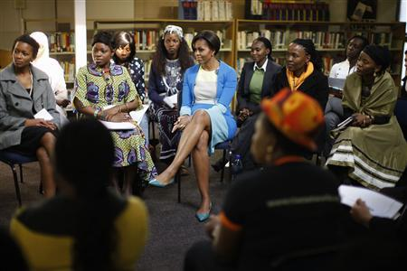 U.S. first lady Michelle Obama participates during breakout sessions at the Young African Youth Leaders Forum in Johannesburg, June 22, 2011. REUTERS/Charles Dharapak/Pool