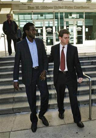 Grammy award winner Buju Banton (L) of Jamaica leaves the federal courthouse with attorney David Markus (R) in Tampa, Florida, February 14, 2011. REUTERS/Steve Nesius