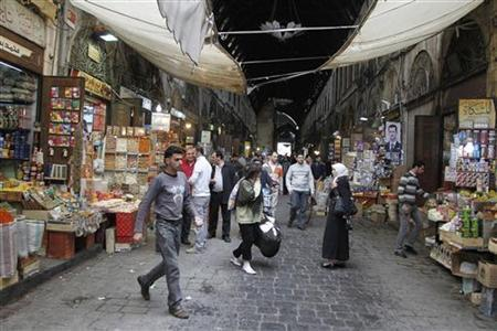 People shop in Bzourya market in old Damascus April 30, 2011. REUTERS/Khaled al-Hariri