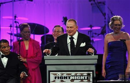 CEO and founder of GoDaddy.com Bob Parsons speaks during the Muhammad Ali Celebrity Fight Night awards banquet as former world heavyweight boxing champion Muhammad Ali (L) and his wife Lonnie Ali (2nd L) look on in Scottsdale, Arizona, March 19, 2011. REUTERS/Joshua Lott
