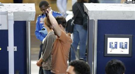 A man is screened with a backscatter x-ray machine at a TSA security checkpoint in terminal 4 at LAX, Los Angeles International Airport, in Los Angeles May 2, 2011. REUTERS/Danny Moloshok