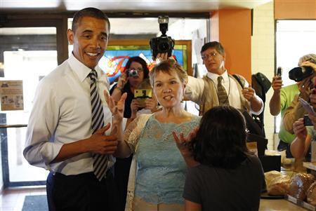 U.S. President Barack Obama stops at a restaurant in Bettendorf, Iowa, June 28, 2011. REUTERS/Kevin Lamarque