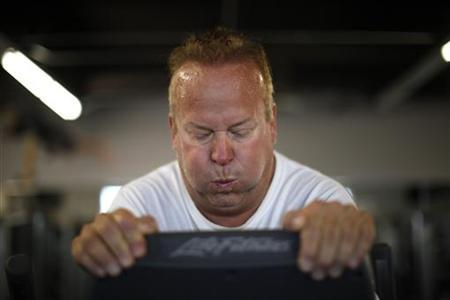 Guest Richard Walker works out on an elliptical machine in the ''mountain'' fitness class at the Biggest Loser Resort in Ivins, Utah September 6, 2010. REUTERS/Rick Wilking
