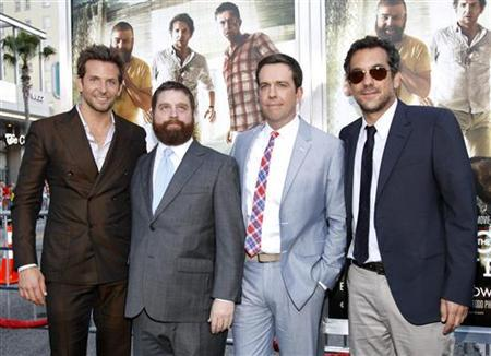 Director of the movie Todd Phillips (R) poses with cast members (from L-R) Bradley Cooper, Zach Galifianakis and Ed Helms at the premiere of ''The Hangover Part II'' at Grauman's Chinese theatre in Hollywood, California May 19, 2011. REUTERS/Mario Anzuoni