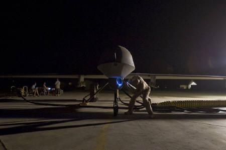 Lt. Col. Geoffrey Barnes, Detachment 1 46th Expeditionary Reconnaissance Attack Squadron commander, performs a pre-flight inspection of an MQ-1B Predator unmanned  drone aircraft in this file image from September 3, 2008. REUTERS/Christopher Griffin/Handout/Files