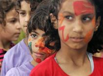 <p>Palestinian children attend a summer camp, organized by the United Nations Relief and Works Agency (UNRWA) at the beach in Gaza City June 27, 2011. REUTERS/Ibraheem Abu Mustafa</p>