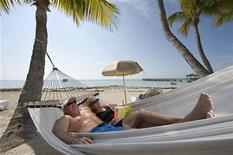 <p>Paul and Kellee Athens relax in a hammock at the Casa Marina Resort in Key West, Florida, February 2, 2011. REUTERS/Rob O'Neal/Florida Keys News Bureau/Handout</p>