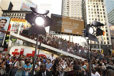A crowd gathers in Times Square to watch celebrities arrive during the premiere of ''Transformers: Dark of The Moon'' in New York June 28, 2011. REUTERS/Lucas Jackson
