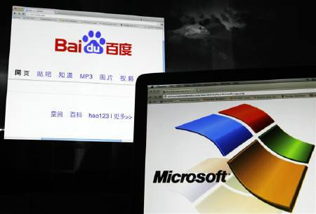 A photo illustration shows Baidu's website and Microsoft's logo on computer screens in Shanghai July 5, 2011. REUTERS/Carlos Barria/