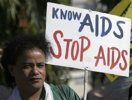 A sex worker holds a placard during an AIDS awareness rally to mark the World AIDS Day in Siliguri December 1, 2008. REUTERS/Rupak De Chowdhuri/Files