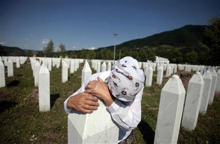 Adila Suljakovic cries at the grave of her son in the Memorial Center in Potocari, near Srebrenica July 3, 2011. REUTERS/Dado Ruvic