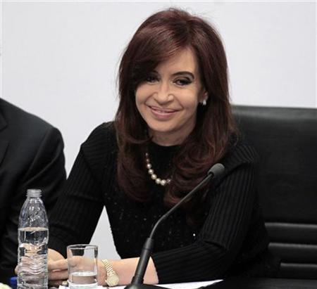 Argentina's President Cristina Fernandez de Kirchner smiles during a ceremony at the Casa Rosada Presidential Palace in Buenos Aires, May 10, 2011. REUTERS/Marcos Brindicci