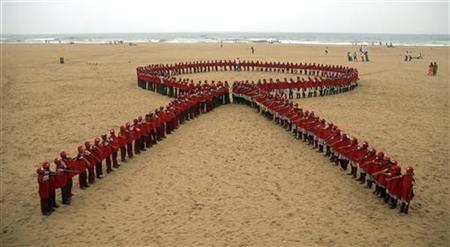 Students form a red ribbon during an HIV/AIDS awareness rally on World AIDS Day at Marina beach in the southern Indian city of Chennai December 1, 2010. REUTERS/Babu