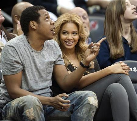Jay Z and his wife Beyonce watching the New Jersey Nets play the Phoenix Suns in Newark, February 28, 2011. REUTERS/Ray Stubblebine