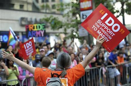 A gay marriage supporter carries a sign at the 41st LGBT (Lesbian Gay Bisexual Transgender) Pride parade in San Francisco on June 26, 2011. REUTERS/Susana Bates