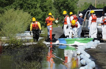 Emergency response crew hired by Exxon Mobil clean up an oil spill along the Yellowstone River in Laurel, Montana, July 5, 2011. REUTERS/John Warner