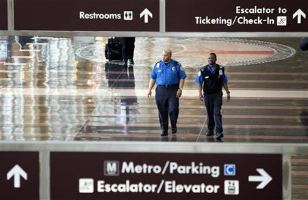 Transportation Security Administration (TSA) employees walk through the concourse at Reagan National Airport in Washington on May 2, 2011. REUTERS/Joshua Roberts