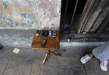 Used mobile phones are displayed for sale at a stall on a street of Havana May 16, 2011. REUTERS/Desmond Boylan