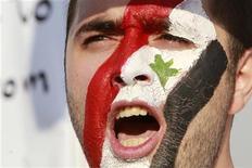 Сирийские службы безопасности взяли штурмом пригород Хараста на севере Дамаска, ранив двух человек, сообщили местные жители и сотрудники организации по правам человека в пятницу. REUTERS/Muhammad Hamed