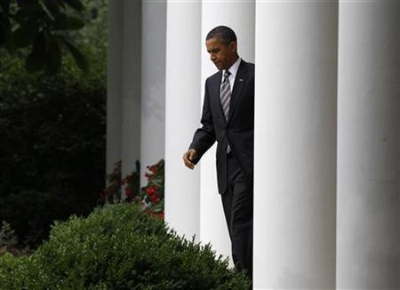 U.S. President Barack Obama arrives to deliver a statement about the monthly jobs report in the Rose Garden of the White House in Washington July 8, 2011. REUTERS/Larry Downing