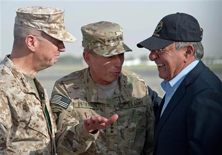 USMC Lt. General John Allen (L) and U.S. Army General David Petraeus (C) greet U.S. Secretary of Defense Leon Panetta after Panetta's arrival in Kabul, Afghanistan, July 9, 2011. REUTERS/Paul Richards/Pool