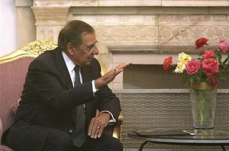 Afghan President Hamid Karzai (not pictured) speaks with the new U.S. Defense Secretary Leon Panetta at the presidential palace in Kabul, July 9, 2011. REUTERS/Ahmad Massoud/Pool
