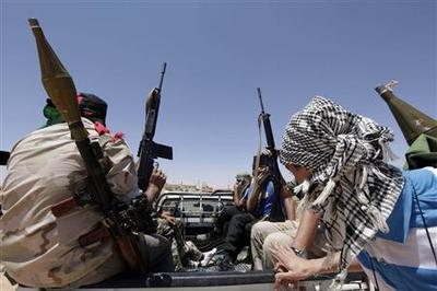 France tells Libya rebels to seek peace with Gaddafi